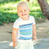 stock photo of laughable  - Baby walking in the park - JPG