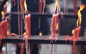 stock photo of emei  - burning incenses and candle in temple - JPG