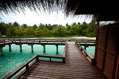 image of chalet  -  Wooden chalets over water in tropical island - JPG