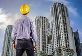 image of workplace safety  - Asian construction engineer wearing safety helmet protective - JPG