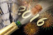 foto of midnight  - Happy new year 2016 with flying cork of popping champagne - JPG