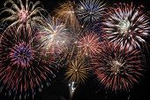 picture of midnight  - Happy new year with big cascade firework at midnight - JPG