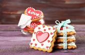 foto of glass heart  - Heart shaped cookies for valentines day in glass jar on color wooden background - JPG