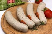 foto of raw chicken sausage  - raw chicken sausages with tomato on the board - JPG