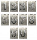 stock photo of arabic numerals  - Metal type numbers isolated on white - JPG