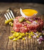 stock photo of tartar  - Close up of beef tartar with capers gherkins - JPG
