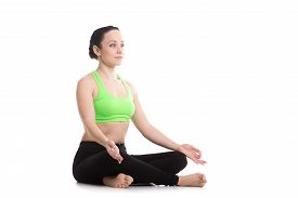 pic of pranayama  - Serene girl practicing yoga Sitting in Easy  - JPG