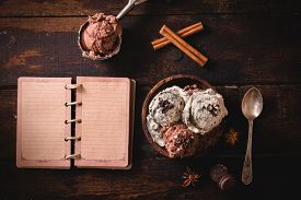 picture of ijs  - Ice cream in wooden bowl and blank book on wooden background - JPG