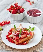 stock photo of french-toast  - French toast with berries and jam for breakfast - JPG