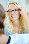 picture of spectacles  - Fitting spectacles on a lady - JPG