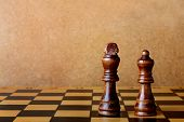 picture of chessboard  - One chess king dominating another on the chessboard - JPG