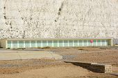 image of beach hut  - Beach huts under chalk cliffs at Rottingdean near Brighton East Sussex England - JPG