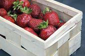 stock photo of casket  - A casket full of red ripe strawberries - JPG