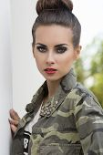 picture of charming  - fashion close-up outdoor portrait of charming woman with dark make-up. creative hair-style and urban military shirt looking in camera ** Note: Soft Focus at 100%, best at smaller sizes - JPG