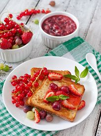 stock photo of french toast  - French toast with berries and jam for breakfast - JPG