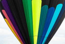 stock photo of lifting-off  - striking pattern of colors on the nylon envelope of a hot air balloon inflated for lifting off into the air - JPG