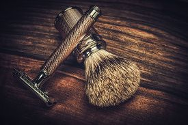 picture of razor  - Safety razor and shaving brush on a wooden background  - JPG