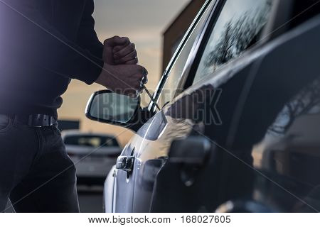 Auto Thief In Black Balaclava