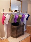 foto of niece  - Nice neat Christmas stocking display at my Nieces - JPG