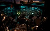 stock photo of attack helicopter  - The cockpit of a Chinook helicopter at night with lights glowing - JPG