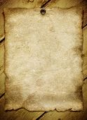 old paper on wood background with space for your text or image