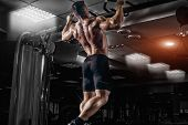 Muscle Athlete Man In Gym Making Elevations. Bodybuilder Training In Gym poster