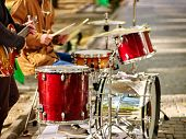 Festival music band. Hands playing on percussion instruments in city park . Drums with sticks closeu poster