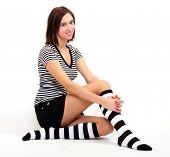 picture of knee-high socks  - Sexy girl in funny socks posing on her knees - JPG
