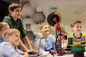 education, children, technology, science and people concept - group of happy kids with 3d printer an poster