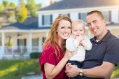 Happy Young Military Family in Front of Their House. poster