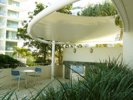 picture of modern building  - BBQ area reserved for residents and guests of the luxury apartment building - JPG