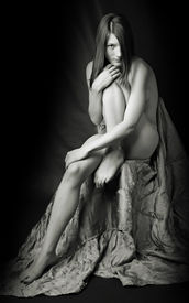 stock photo of striper  - Sitting beautiful naked girl  - JPG