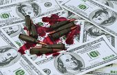 War Is A Bloody Business. Bullets And Banknotes In The Blood As A Symbol Of World Military Conflicts poster