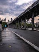 Young Tourist Walking By Pont De Bir Hakeim Metro Bridge Paris France Paris France During Summer Wit poster