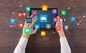Hand touching multitask tablet with cloud wifi message social media call icons and symbols concept poster