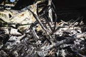 Damaged Burnt Car Metallic After Arson Fire With Burnt Debris After Intense Burning Fire Disaster Ru poster