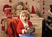 Happy Family Celebrate New Year And Christmas. New Year Small Boy With Clock. Winter Holiday And Mid poster