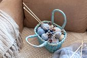 Knitting In Cozy Home Interior. Winter Or Christmas Mood, Atmosphere. Knitted Plaid, Blue Wicker Bas poster