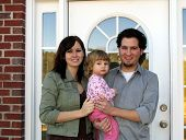 picture of dream home  - family at the front door of their new home - JPG