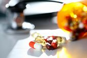 Tablets Scattered Blue And Red Color On The Table Of Pharmaceutical Laboratory Pill For The Prescrip poster