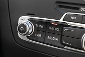 Media And Navigation Control Buttons Of A Modern Car. Car Interior Details. Black Leather Interior O poster