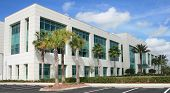 stock photo of building exterior  - Modern commercial building on a beautiful day - JPG