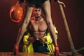 Firefighter Sexy Body Muscle Man Holding Saved Girl. Hot And Sexy. Passionate Couple Concept. Vibran poster