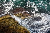 Aerial Top View Of Sea Waves Hitting Rocks On The Beach With Turquoise Sea Water. Amazing Rock Cliff poster