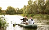 Friends Fishing From Boat On Sunny Day. Recreational Activity poster