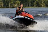foto of jet-ski  - Man riding wave runner in river enjoying a nice summer day - JPG