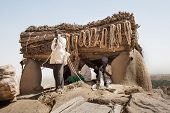 Men At Work Near The Toguna Of The Village, Mali, Africa.