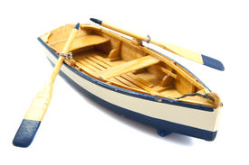 image of sloop  - Wooden boat with paddles isolated over white - JPG