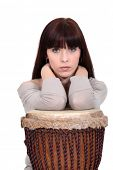 foto of bongo  - Brunette leaning on bongo drum - JPG