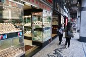 MACAU, CHINA - NOVEMBER 2, 2012: Many small shops in Macao sell gold products, brilliants and watche